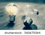 small light bulb standing and... | Shutterstock . vector #560670364