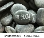 stone word freedom | Shutterstock . vector #560687068