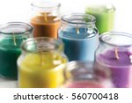 aroma candles with colorful wax. | Shutterstock . vector #560700418