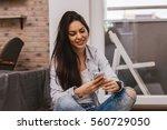pretty girl using her... | Shutterstock . vector #560729050