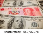 chinese yuan note and u.s.... | Shutterstock . vector #560732278