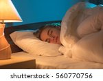 the young woman sleeping on the ... | Shutterstock . vector #560770756