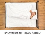 the woman lie on the bed. view... | Shutterstock . vector #560772880