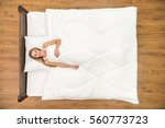 the woman lay on the bed and... | Shutterstock . vector #560773723