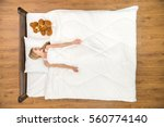 the happy woman lay on the bed... | Shutterstock . vector #560774140