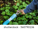 boy hand try to turn off water... | Shutterstock . vector #560790136