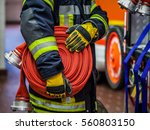 Fireman in action with a rolled ...