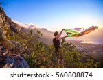Small photo of Man holding a south african flag over Cape Town