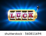 luck word on slot machine ... | Shutterstock .eps vector #560811694