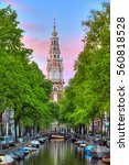 Stock photo beautiful groenburgwal canal in amsterdam with the soutern church zuiderkerk at sunset in summer 560818528