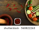 recipe book with fresh herbs... | Shutterstock . vector #560822263