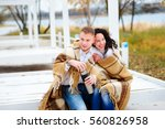 young couple embracing and... | Shutterstock . vector #560826958