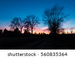 colorful epic sunset and house... | Shutterstock . vector #560835364