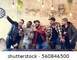 men use mobile phone selfie... | Shutterstock . vector #560846500