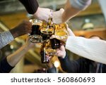 hands hold beverage beers... | Shutterstock . vector #560860693