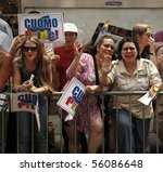NEW YORK - JUNE 27: Unidentified supporters of Andrew Cuomo bid for governor at the 2010 New York City Gay Pride March on the streets of Manhattan on June 27, 2010 in New York City. - stock photo