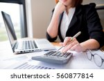asian female accountant or... | Shutterstock . vector #560877814