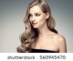 beautiful woman face close up... | Shutterstock . vector #560945470