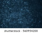 dust particles background with... | Shutterstock . vector #560954200