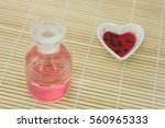 Small photo of Elixir of love, Prepare Red philter in heart bowl and finished product in bottle on bamboo mat.
