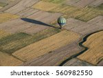 Small photo of Hot-air balloon has made touchdown on field. Aerial view.