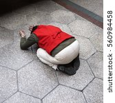 Small photo of Worshipper devotee praying kneeling bowing in respect pray blessing asking on granite marble stone concrete tile floor of temple