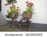 Reused Bycycle With Baskets Of...
