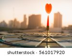 red dart arrow hitting in the... | Shutterstock . vector #561017920