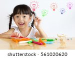 asian girl are playing... | Shutterstock . vector #561020620
