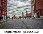 gloomy autumn clouds over red... | Shutterstock . vector #561055360