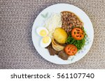 brazilian food dish with a view ... | Shutterstock . vector #561107740