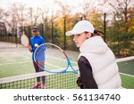 two young attractive tennis... | Shutterstock . vector #561134740