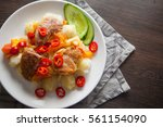 pork chops with boiled potato... | Shutterstock . vector #561154090