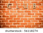 red brick wall vignette background featuring club sign - stock photo