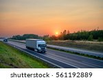 white trucks driving on the... | Shutterstock . vector #561192889