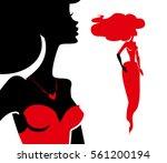 female silhouette in red dress. ... | Shutterstock .eps vector #561200194