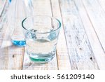 Water In A Glass On A Wooden...