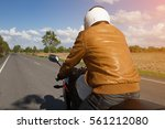motorcycle drivers on road in... | Shutterstock . vector #561212080