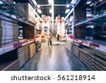 blurred customers shopping in... | Shutterstock . vector #561218914