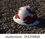 A Construction Hard Hat Left...