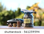 money jar with coins and... | Shutterstock . vector #561259594