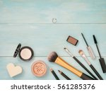 set of make up on turquoise... | Shutterstock . vector #561285376