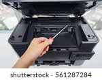 engineer with screwdriver for... | Shutterstock . vector #561287284