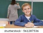 happy little boy doing class... | Shutterstock . vector #561287536