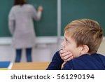 young schoolboy sitting...   Shutterstock . vector #561290194