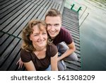 mother with her adult son... | Shutterstock . vector #561308209
