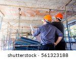 two engineer checking the... | Shutterstock . vector #561323188