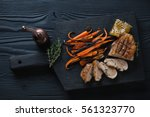 fried duck breast with carrot... | Shutterstock . vector #561323770