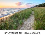 A Walk On The Beach. Sandy path winds along the shore of Lake Michigan with a sunset horizon and sand dunes as a backdrop. Muskegon, Michigan