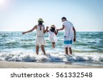 family of three having fun on... | Shutterstock . vector #561332548